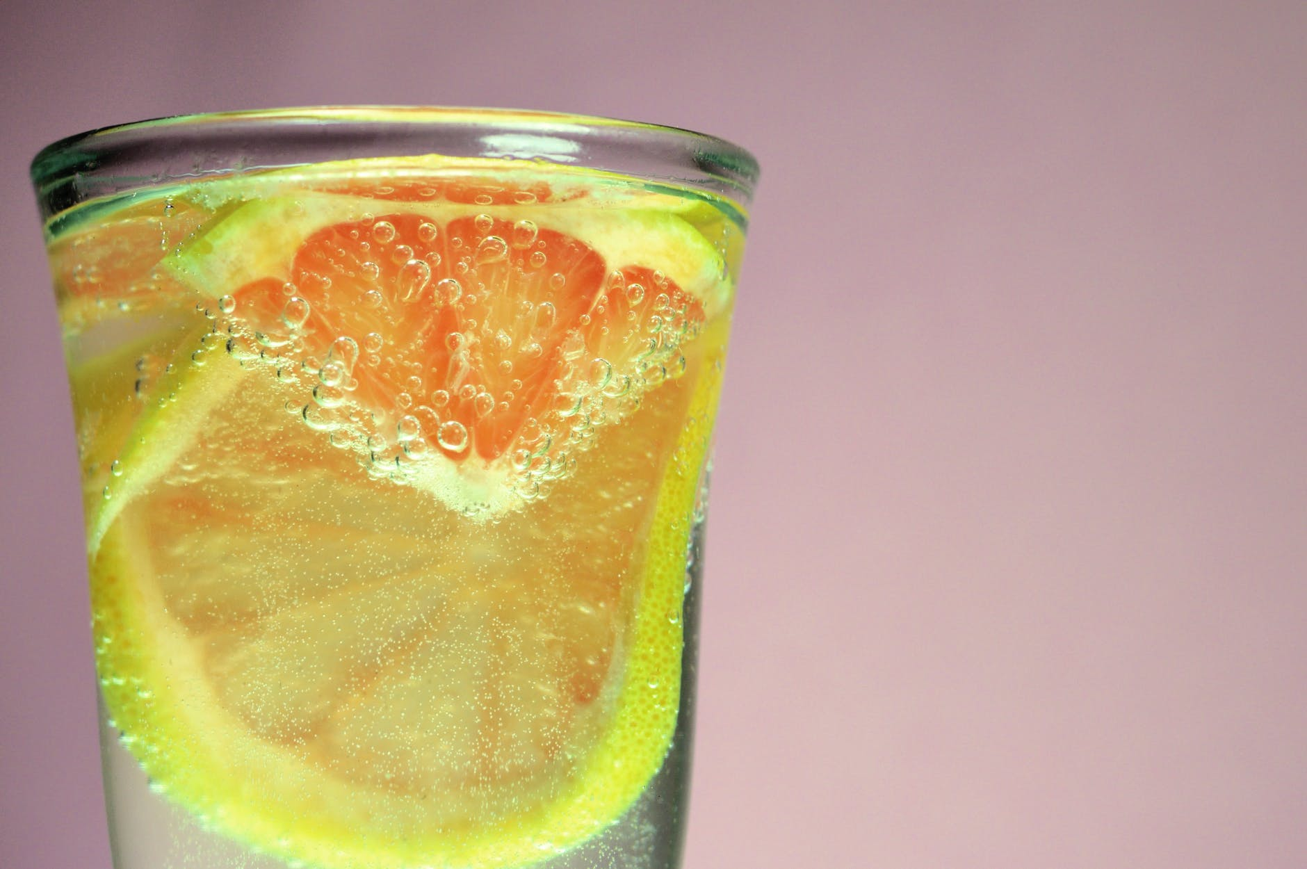 selective photography of citrus drink